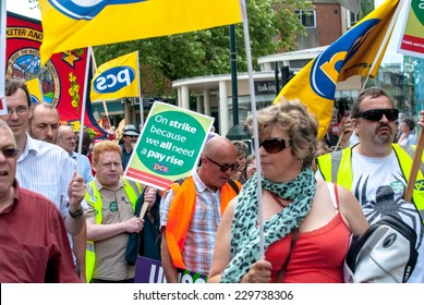 EXETER - JULY 10: PCS members walk into Princesshay Square during the public sector workers national day of action in Exeter City Centre on July 10,  2014 in Exeter, Devon, UK