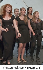 EXETER - JUNE 3: Singers from University of Exeter Soul Choir perform live on the Global Community Stage at the Exeter Respect Festival on June 3, 2012 in Exeter, UK