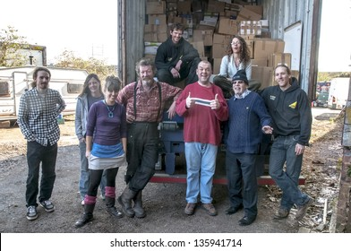 EXETER - MARCH 14: Members & volunteers from BookCycle UK pose at the Bookcycle UK warehouse after loading the container bound for Ghana on March 14,  2013 in Exeter, Devon, UK