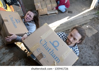 EXETER - MARCH 14: Members and volunteers from BookCycle UK carry boxes of books and load them onto the container boiund for Ghana at the Bookcycle UK on March 14, 2013 in Exeter, Devon, UK