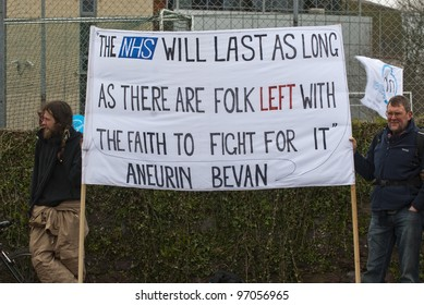 EXETER - MARCH 7: Protestors hold up a sign , during the NHS reform protest outside the Royal Devon & Exeter Hospital on March 7, 2012 in Exeter, UK