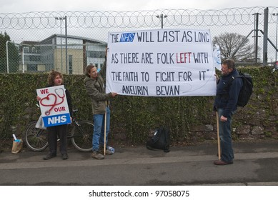 EXETER - MARCH 7:  Protestors hold up a sign, during the NHS reform protest outside the Royal Devon & Exeter Hospital on March 7, 2012 in Exeter, UK