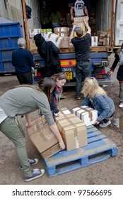 EXETER - MARCH 9: Volunteers from BookCycle loads a box into the container that is taking donated book to Ghana on March 9,  2012 in Exeter, UK