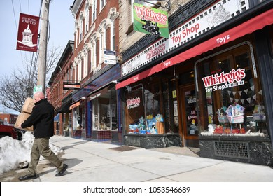 Exeter, N.H./USA - March 23, 2018: A man carries boxes out of Whirlygigs, a small toy store in downtown Exeter, N.H. Independent toy stores have outlived Toys R Us and compete with Amazon.com.