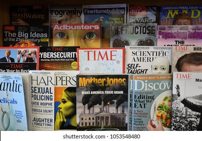 Exeter, N.H./USA - March 23, 2018: Time magazine sits in a rack in local bookstore days after parent company Meredith announced 200 layoffs and Time's possible sale.