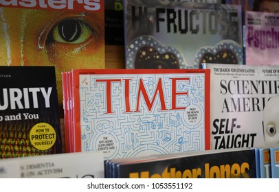 Exeter, N.H./USA - March 23, 2018: Time magazine sits in a rack in a local bookstore days after Time's parent company, Meredith, announced 200 layoffs and the possible sale of Time.