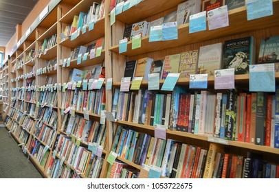Exeter, N.H./USA - March 23, 2018: A wall of books with sticky notes written by staff members at Water Street Books, an independent book store that has thrived in the age of Amazon.com.