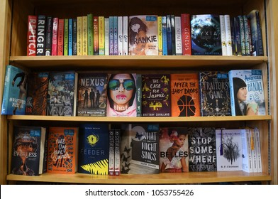 Exeter, N.H./USA - March 23, 2018: Young adult fiction books on display at Water Street Books, an independent book store. Titles by or about young women get prominent placement.