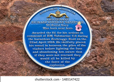 Exeter, UK - July 31st 2019: A blue plaque in Cathedral Close in Exeter, marking the location where Richard Douglas Sandford - winner of the Victoria Cross during WW1 was born.