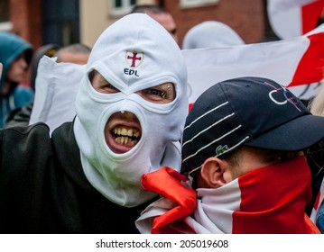 EXETER, UK - NOVEMBER 16: English Defence League member in a white balaclava during the English Defence League march and rally November 16, 2013 in Exeter, Devon, UK