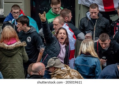 EXETER, UK - NOVEMBER 16: English Defence League member shouting out during the English Defence League march and rally November 16, 2013 in Exeter, Devon, UK