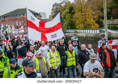 EXETER, UK - NOVEMBER 16: English Defence League members marching along New North Street during the English Defence League march and rally November 16, 2013 in Exeter, Devon, UK