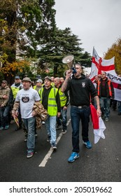 EXETER, UK - NOVEMBER 16: English Defence League Exeter branch leader Kieran Hallett leads the shouts as they walk during the English Defence League march and rally November 16, 2013 in Exeter, Devon, UK