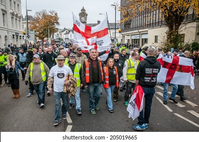EXETER, UK - NOVEMBER 16: English Defence League members march along the street during the English Defence League march and rally November 16, 2013 in Exeter, Devon, UK