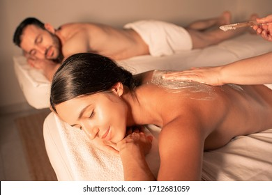 Exfoliate older skin with a body scrub. time for pampering body and skin at spa. Couple getting peel procedure after body massage.
