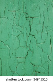 Exfoliating green paint on a wooden surface