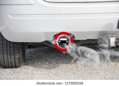 Exhaust from a car with the traffic sign for driving ban, in german Fahrverbot for diesel motor vehicles in the low emission zone of some cities of Germany