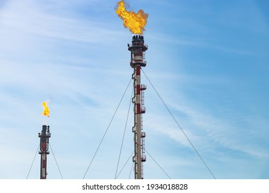 Exhaust chimneys of the petrochemical industry with the burning flame of Palos de la Frontera in Huelva, Andalusia, Spain.
