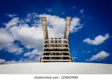 The exhaust of a cruise ship is a  supersized pollution problem. The floating city will switch off its auxiliary engines, fire up its three giant diesels and head to the open sea.