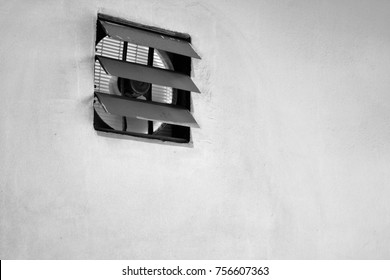 Exhaust fan on the dirty wall, black and white tone
