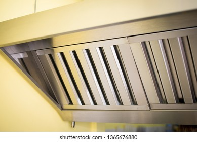 Exhaust systems, hood filters detail in a professional kitchen.