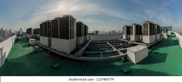 Exhaust vents of industrial air conditioning and ventilation units. Skyscraper roof top from high building.