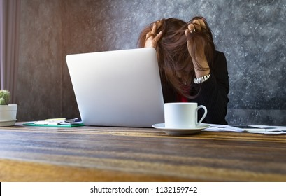 Exhausted of business woman overwork  headache,stress which her a has tried  work hard and headache out of time pressure in the office