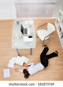 Exhausted Businesswoman Fainted On Floor At Workplace
