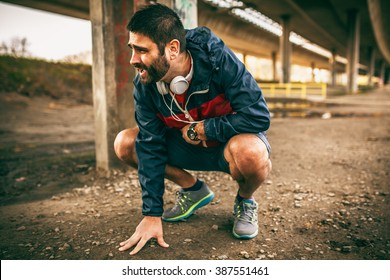 Exhausted man resting after jogging