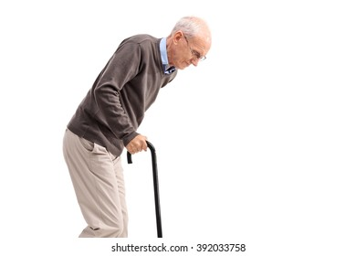 Exhausted old man walking with a cane isolated on white background