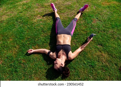 exhausted runner after fitness running workout catching breath