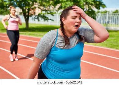 Exhausted runner touching her head with funny facial expression