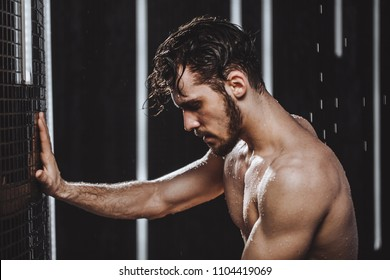 exhausted sportsman in the shower bath. remove stress