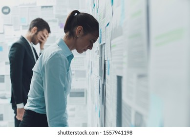 Exhausted stressed business team overloaded with financial reports and problems
