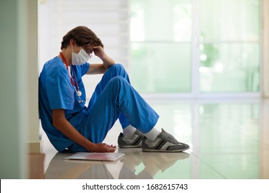 Exhausted tired doctor or nurse. Virus outbreak. Coronavirus pandemic. Clinic and hospital medical stuff working over hours. Overworked professional. Stress and depression.
