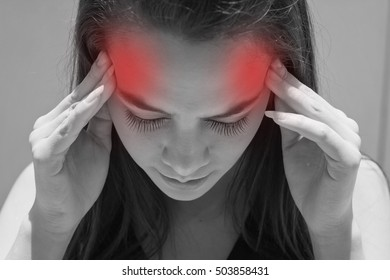 exhausted woman with headache, migraine, stress, hangover, mental problem under day time strong sunlight condition