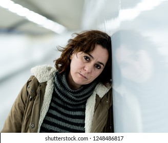 Exhausted woman suffering depression and anxiety in subway tunnel in Work-life balance issues Negative body image Financial troubles and Stressful life events Mental health and loos of love