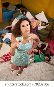 Exhausted  woman with wine and girls at sleepover