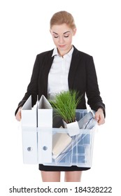 Exhausted Young Businesswoman Holding Basket Over White Background