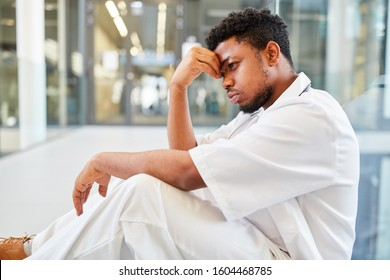 Exhausted young doctor with burnout due to overtime and stress in the hospital