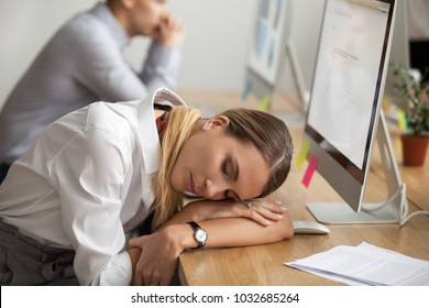 Exhausted young woman taking break to rest and having nap at workplace, tired of computer work businesswoman lying asleep at desk, employee sleeping dozing in office, lack of sleep overwork concept