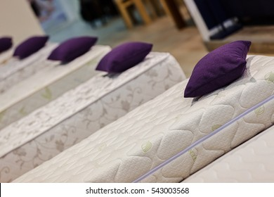 exhibit the pattern of the mattress to the bed, note shallow depth of field