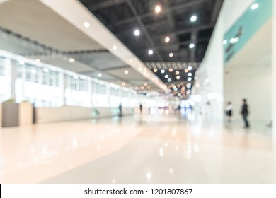 Exhibition event convention hall business blur background of tech expo, trade fair, passenger terminal or museum gallery lobby with blurry interior large corridor hallway white room empty space