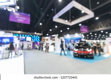 Exhibition event hall blur background of vehicle trade fair business, international automobile expo showcase, motor show with blurry exhibitor tradeshow booth displaying product with people or crowd