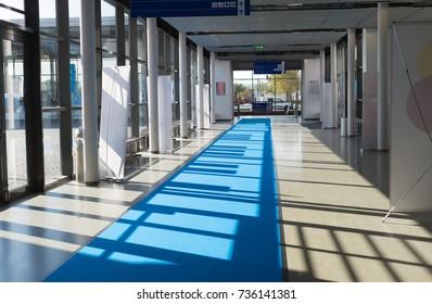 Exhibition fair business expo corridor with carpet and sun through windows