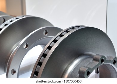 Exhibition of new silver painted car brakes with selective focus.