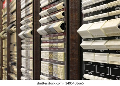 Exhibition stands with samples of decorative elements in the sales office show beautiful original moldings cornices and baseboards