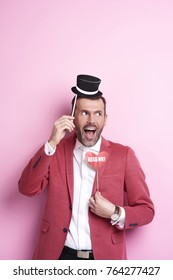 Exhilarated man with photo booth
