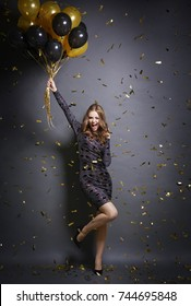 Exhilarated woman dancing at party