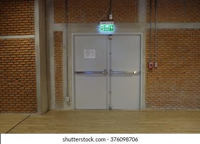 Exit door and brick wall